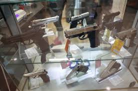 Image result for Hungarians stand in line for guns for fear of disorder as coronavirus spreads
