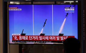 North Korea fires barrage of missiles from ground and air